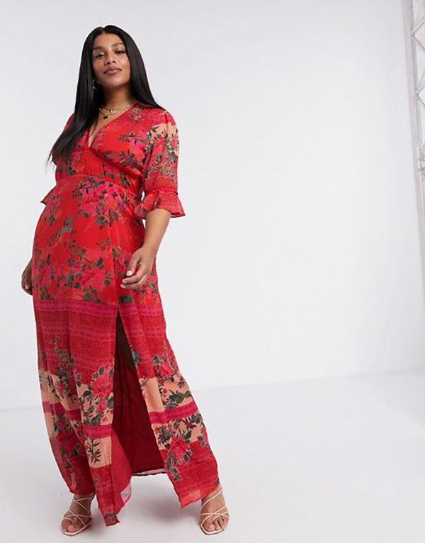 A plus-size model wearing a red fall maxi dress.