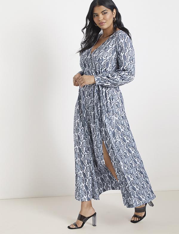 A plus-size model wearing a blue snakeskin fall maxi dress.
