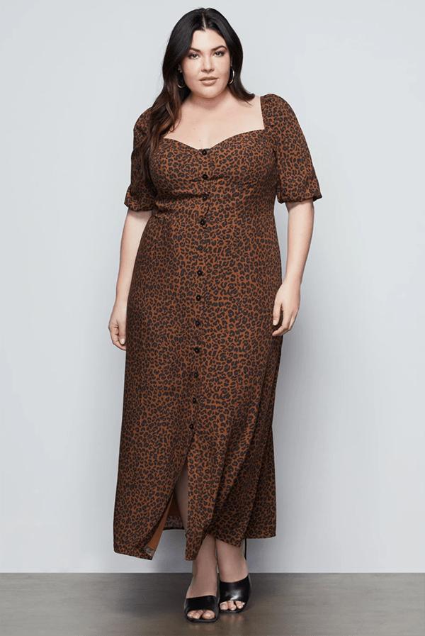 A plus-size model wearing a leopard print fall maxi dress.