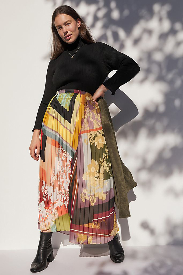 A plus-size model wearing a printed maxi skirt.