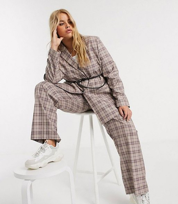 A plus-size model wearing a plaid suit.