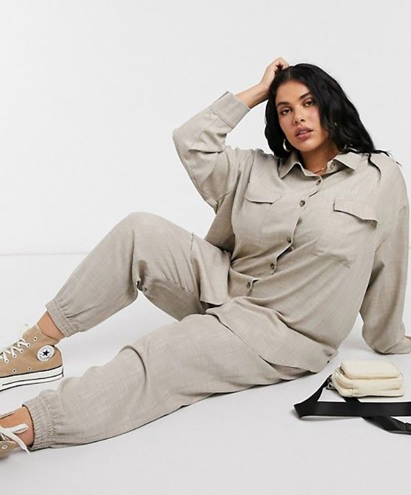 A plus-size model wearing a taupe shacket.