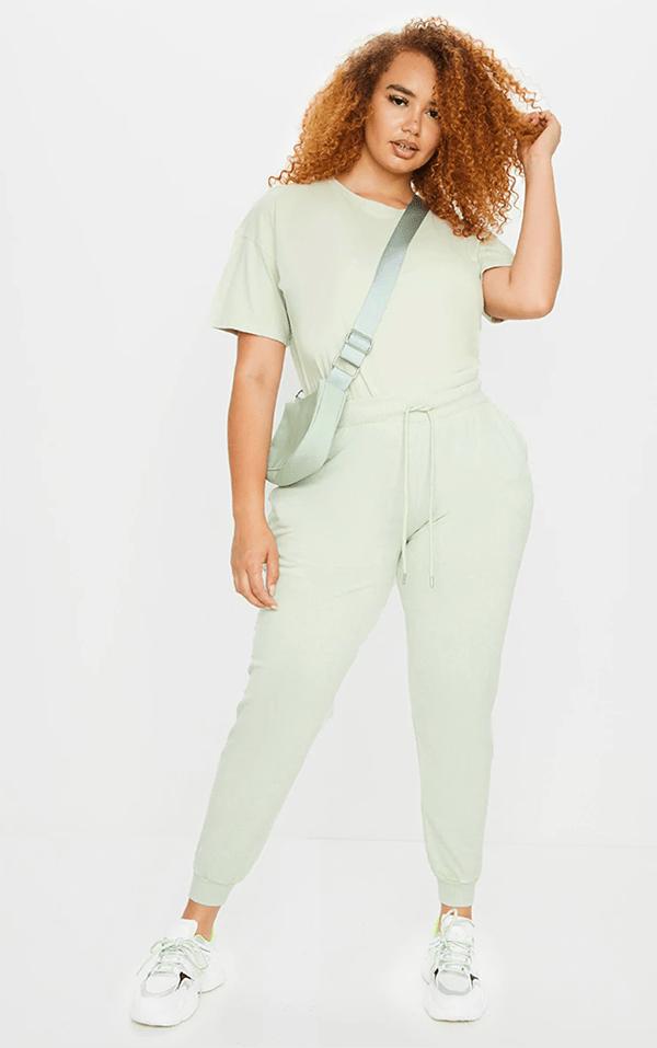 A plus-size model wearing mint sweatpants.