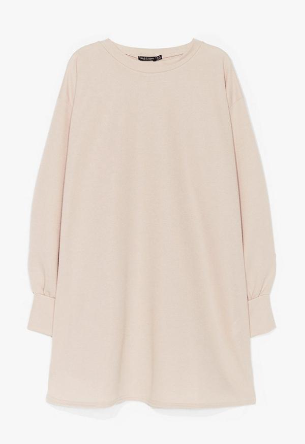 A plus-size beige sweatshirt dress.