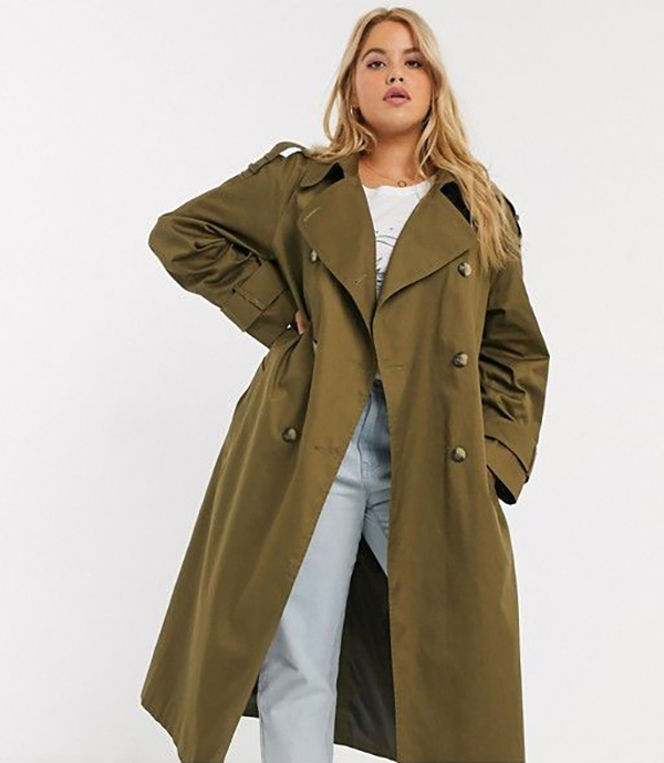 A plus-size model wearing an olive trench coat.