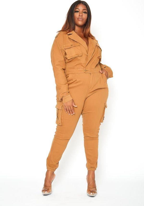 A model wearing a plus-size utility jumpsuit in orange.