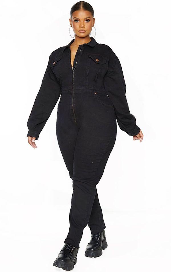 A model wearing a plus-size utility jumpsuit in black.