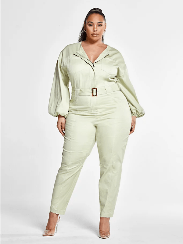 A model wearing a plus-size utility jumpsuit in light green.