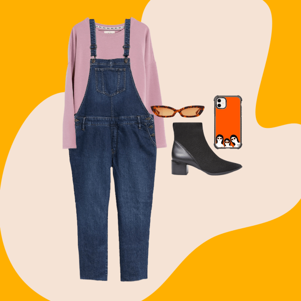 Dark wash plus-size overalls, a purple sweatshirt, black booties, sunglasses, and a phone case.