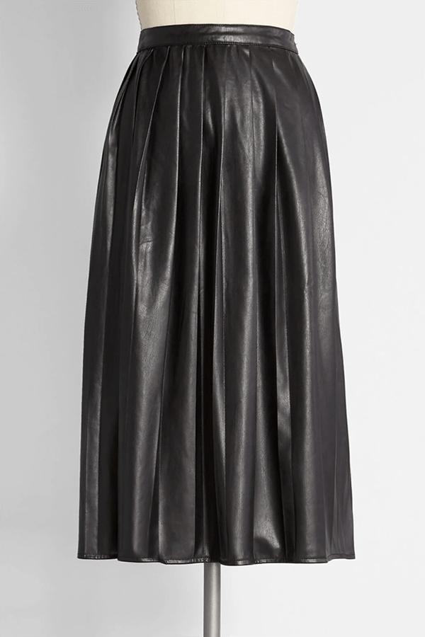 A black pleated leather midi skirt.