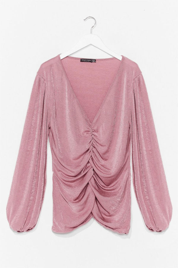 A plus-size mauve ruched long-sleeve top.