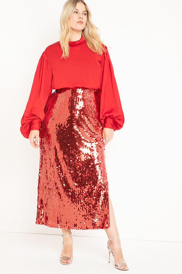 A plus-size model wearing a red sequin maxi skirt.