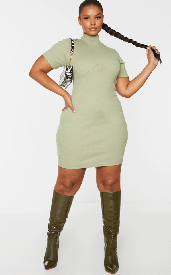 A plus-size model wearing a sexy mint bodycon dress.