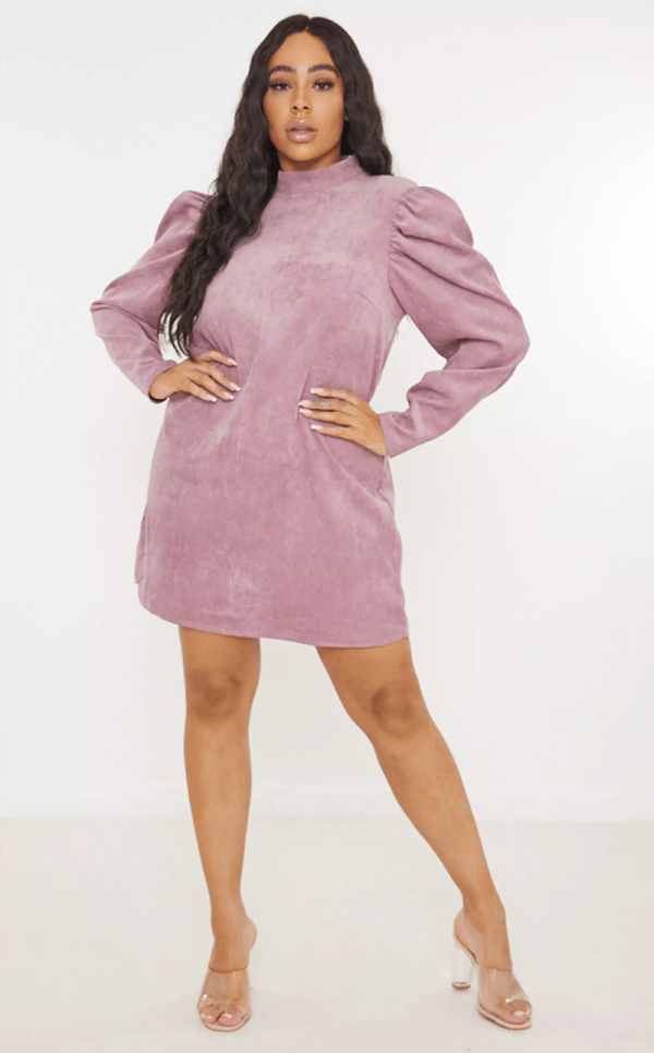 A plus-size model wearing a sexy lavender suede dress.