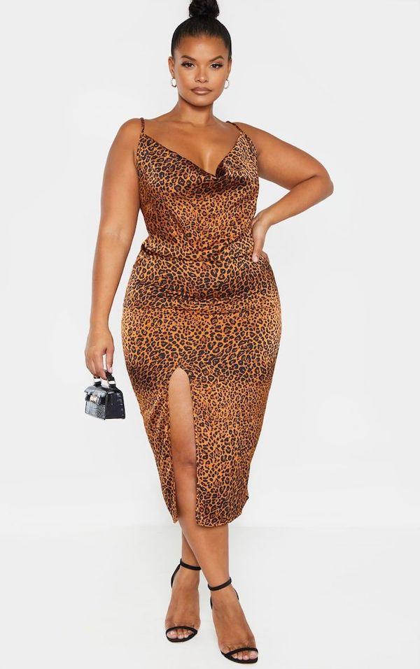 A model wearing a plus-size slip dress in leopard print.