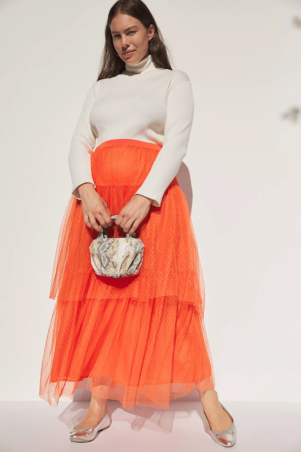 A plus-size model wearing a tulle skirt.