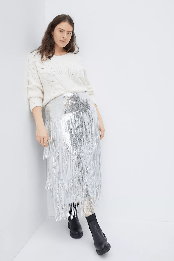 A plus-size model wearing a sequin skirt.