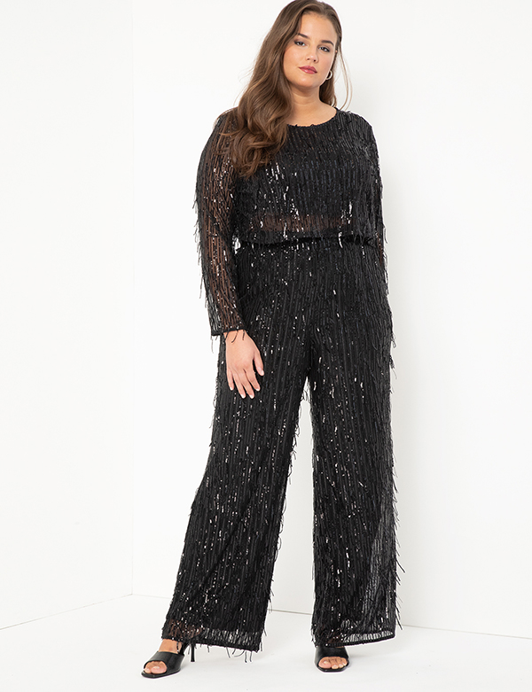 A plus-size model wearing a black sequin fringe two-piece set, which will be marked down at Eloquii's 2020 Black Friday sale.