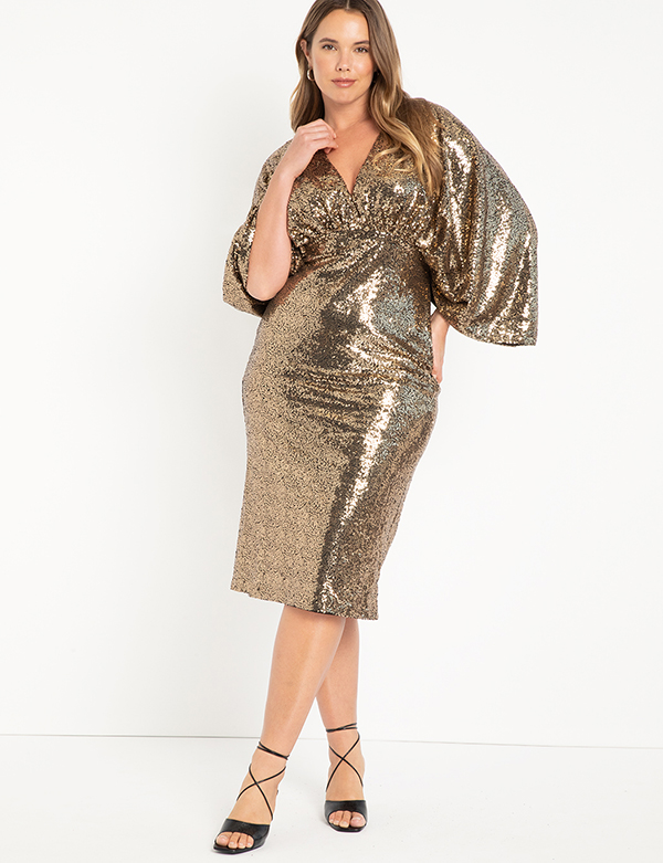 A plus-size model wearing a gold sequin dress, which will be marked down at Eloquii's 2020 Black Friday sale.