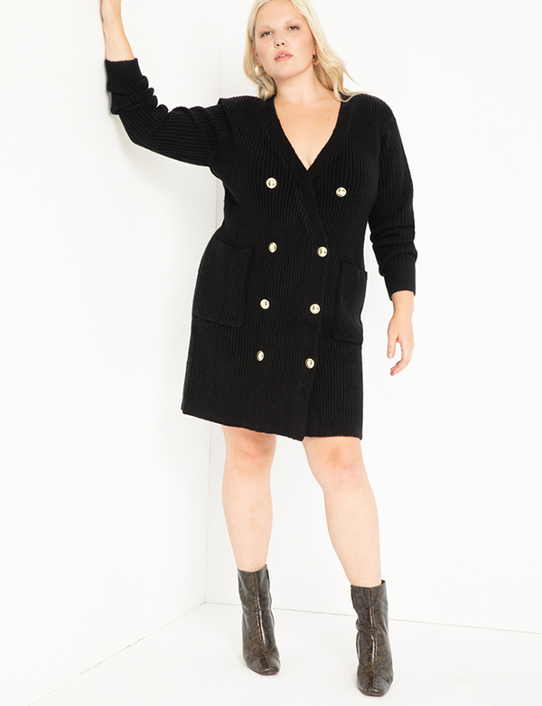 A plus-size model wearing a black knit dress, which will be marked down at Eloquii's 2020 Black Friday sale.