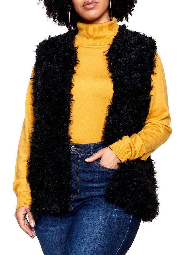 A plus-size model wearing a black faux fur vest.