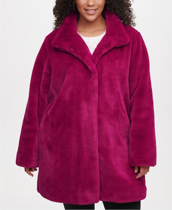 A plus-size model from Macy's wearing a magenta faux fur coat.