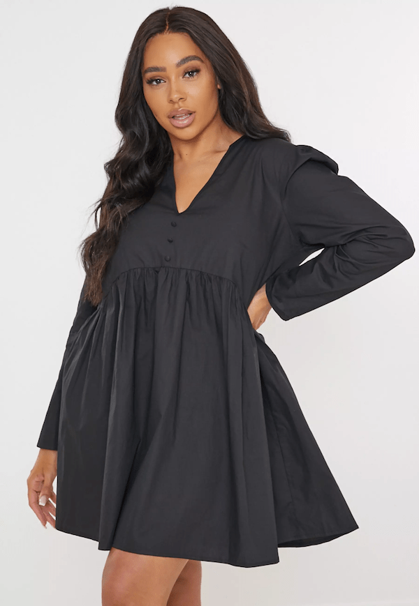 A plus-size model for Missguided wearing a black mini dress.