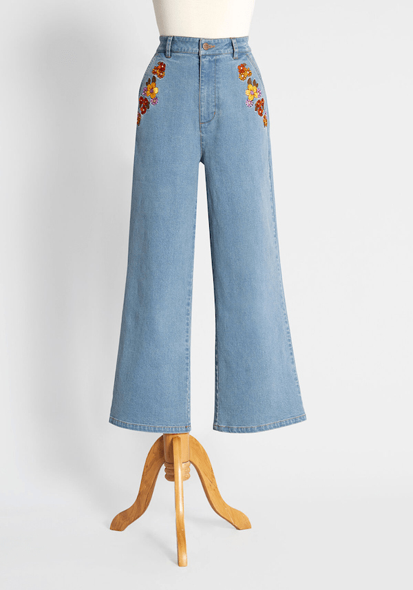 A pair of denim jeans with embroidery on the pockets from ModCloth.