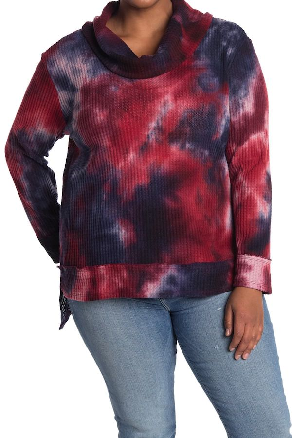 A plus-size model from Nordstrom Rack wearing a tie-dye lounge top.