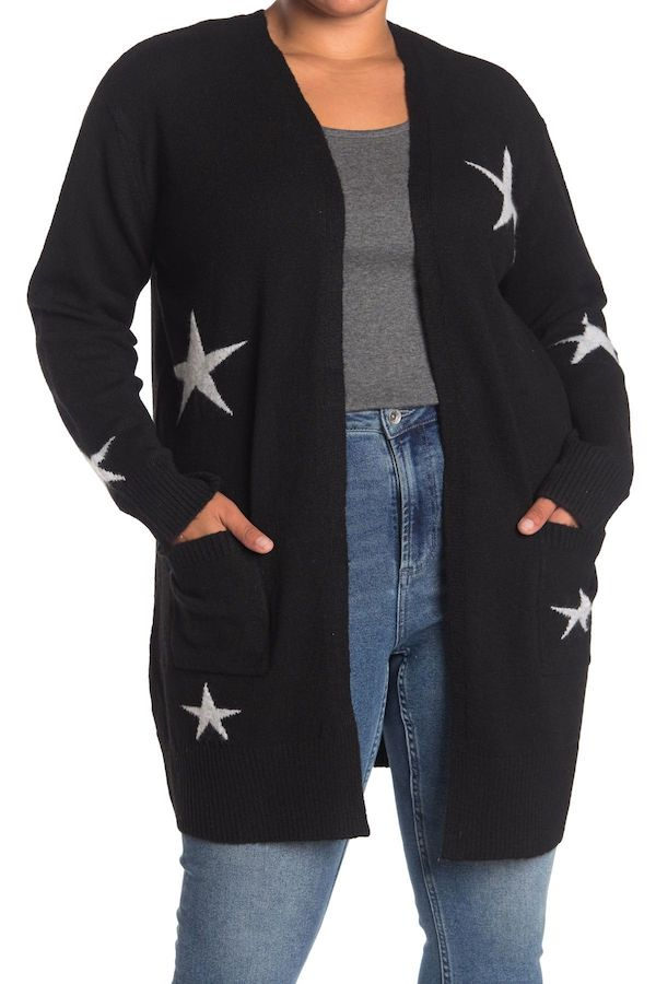 A plus-size model from Nordstrom Rack wearing a black cardigan with gray stars.