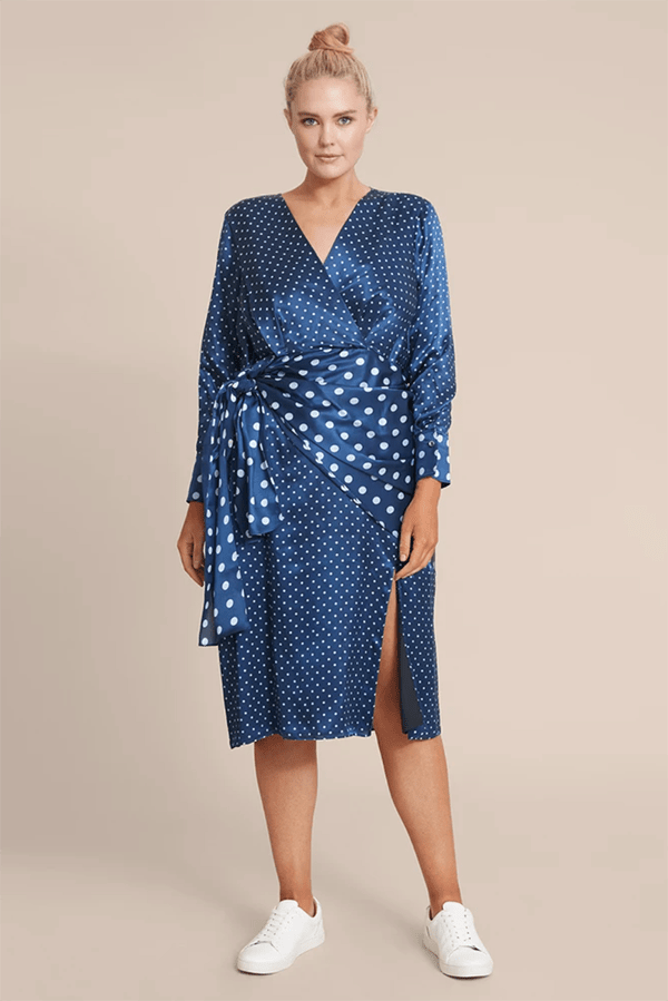 A plus-size model wearing a blue patchwork dress, which is currently marked down at 11 Honore's 2020 Black Friday sale.
