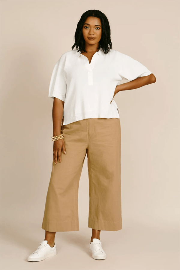 A plus-size model wearing tan wide-leg cropped trousers, which are currently marked down at 11 Honore's 2020 Black Friday sale.