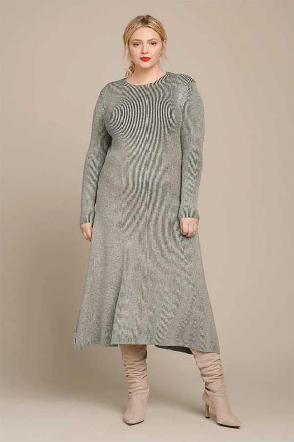 A plus-size model wearing a dress, which is currently marked down at 11 Honore's 2020 Black Friday sale.