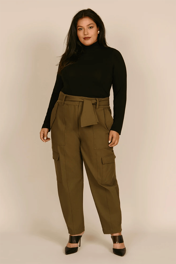 A plus-size model wearing olive green trousers, which are currently marked down at 11 Honore's 2020 Black Friday sale.