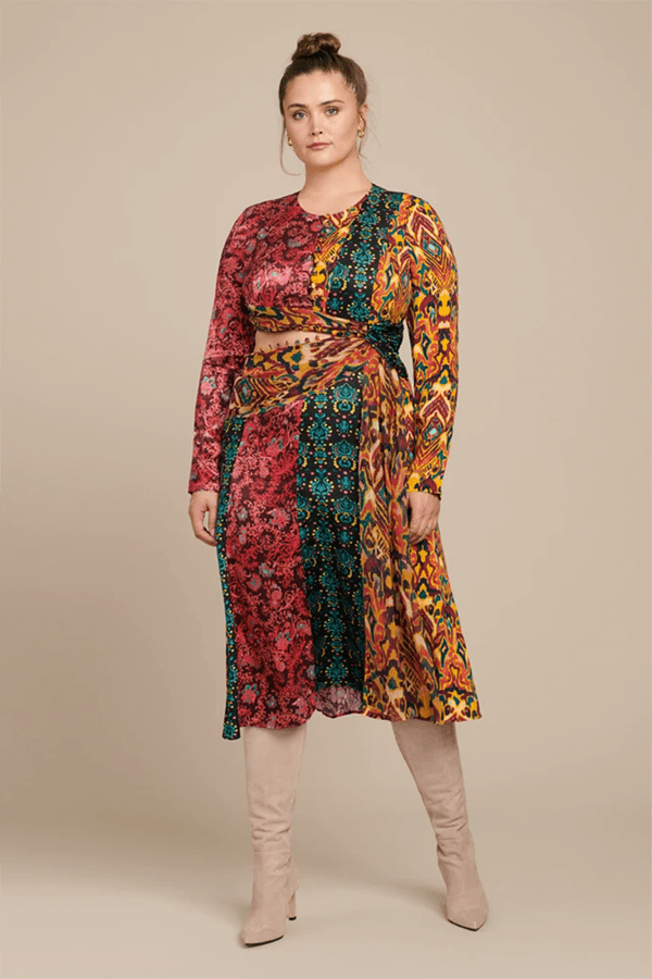 A plus-size model wearing a patchwork dress, which is currently marked down at 11 Honore's 2020 Black Friday sale.