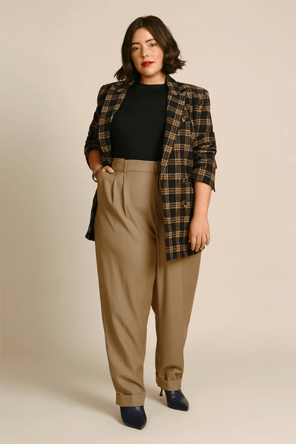 A plus-size model wearing tan trousers, which are currently marked down at 11 Honore's 2020 Black Friday sale.