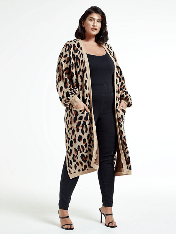 A plus-size model wearing an animal print cardigan, which will be marked down at Fashion to Figure's 2020 Black Friday sale.