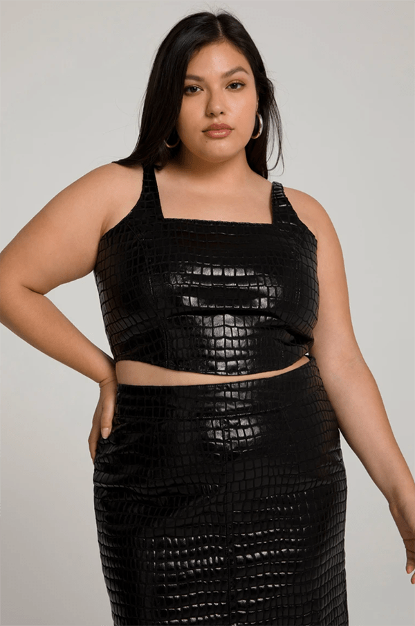 A plus-size model wearing a black croc top, which will be marked down at Good American's 2020 Black Friday sale.