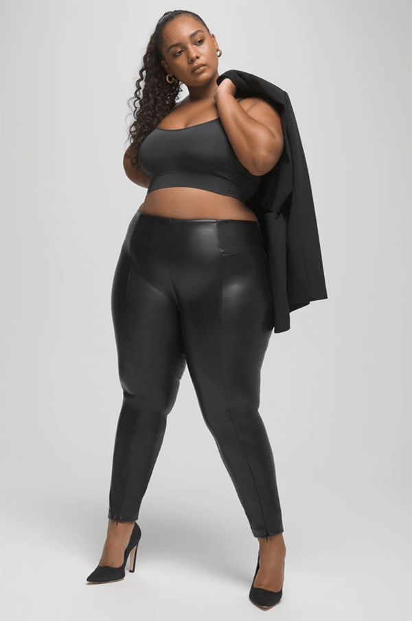A plus-size model wearing leather-look leggings, which will be marked down at Good American's 2020 Black Friday sale.