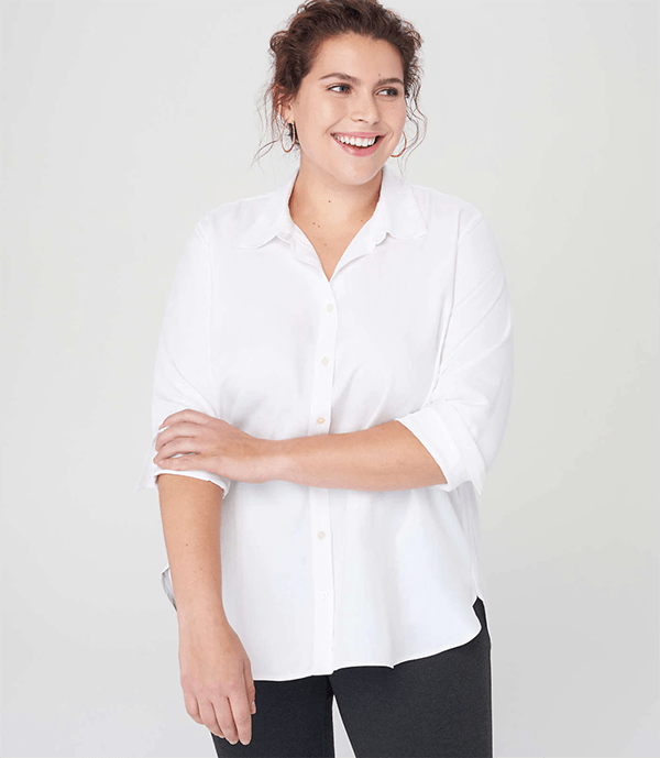 A plus-size model wearing a white button-up top, which will be marked down at Loft's 2020 Black Friday sale.