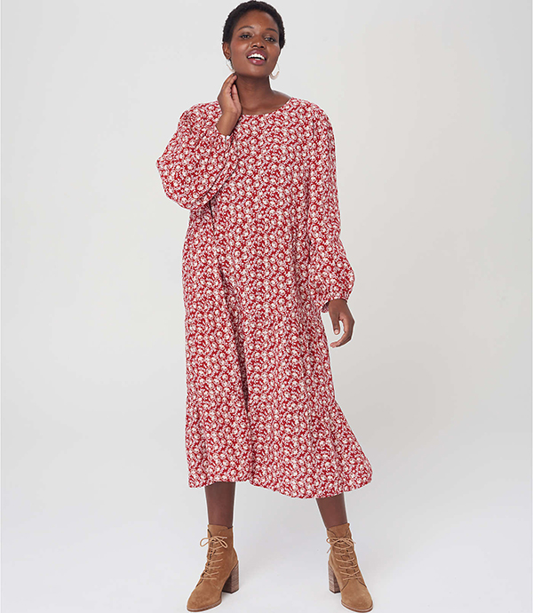 A plus-size model wearing a red printed dress, which will be marked down at Loft's 2020 Black Friday sale.