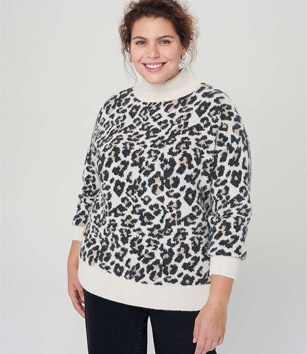 A plus-size model wearing an animal print sweater, which will be marked down at Loft's 2020 Black Friday sale.