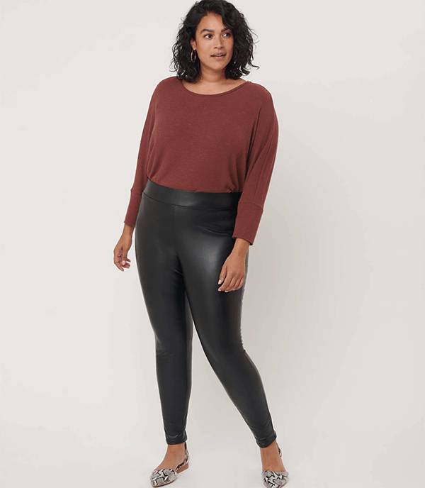 A plus-size model wearing a pair of leather-look leggings, which will be marked down at Loft's 2020 Black Friday sale.