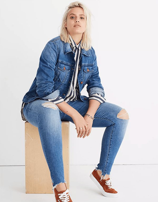A plus-size model wearing a denim jacket, which will be marked down at Madewell's 2020 Black Friday sale.