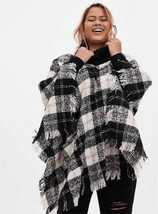 A plus-size model wearing a plaid shawl, which will be marked down at Torrid's 2020 Black Friday sale.