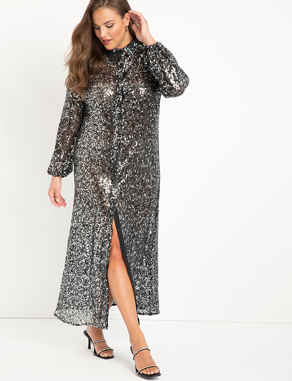 A plus-size model wearing a silver sequin holiday dress from Eloquii.