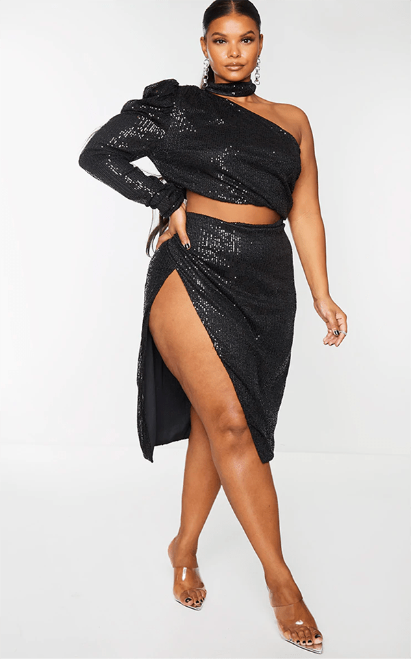 A plus-size model wearing a black sequin two-piece set, which will be marked down at PrettyLittleThing's Black Friday 2020 sale.