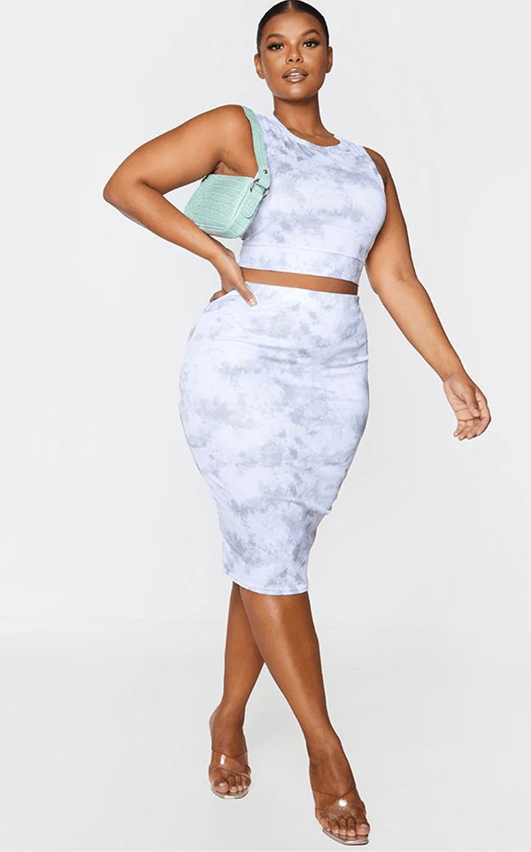 A plus-size model wearing a marble two-piece, which will be marked down at PrettyLittleThing's Black Friday 2020 sale.