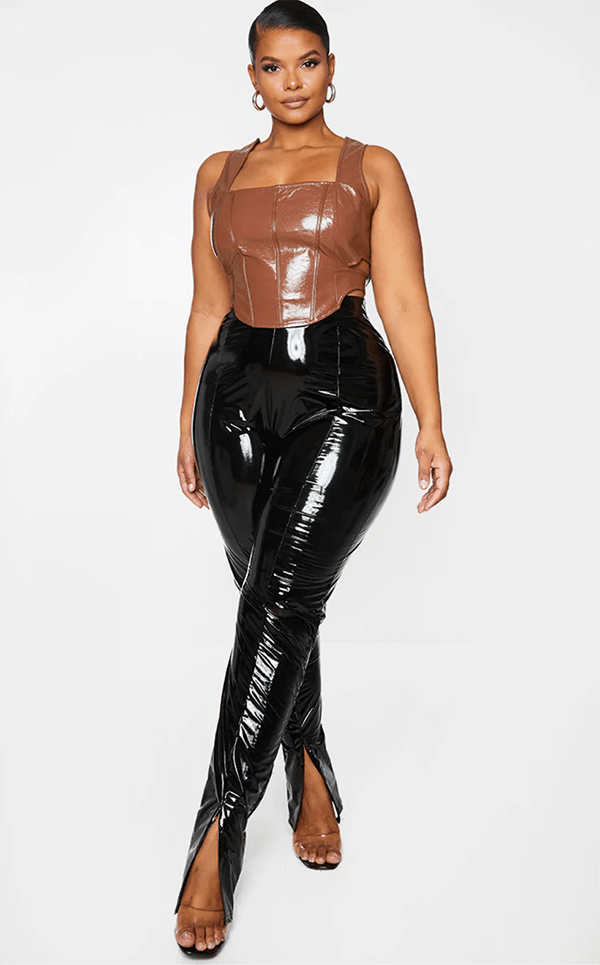 A plus-size model wearing black vinyl leggings, which will be marked down at PrettyLittleThing's Black Friday 2020 sale.