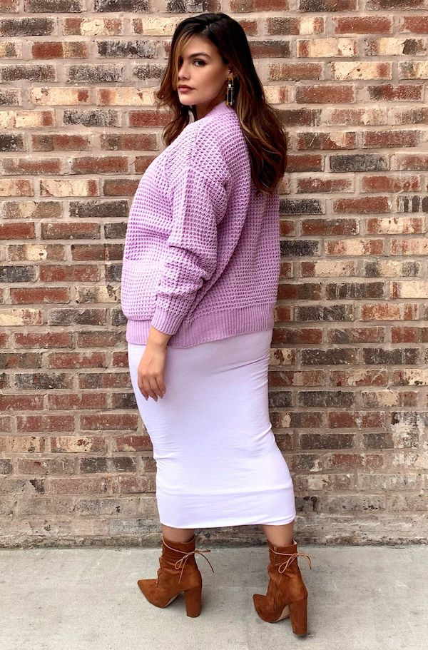 A model from Rebdolls wearing a lavender cardigan.